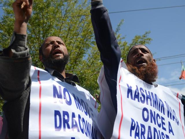 Supporters of the Jammu-Kashmir Salvation movement (JKSM), shout slogans during a protest in Srinagar.