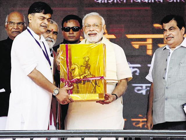 Prime Minister Narendra Modi receives a memento from BJP MP RK Singh during laying of the foundation stone of four-lane Patna-Buxar road and a bridge parallel to the Abdul Bari bridge over river Sone at Koilwar near Ara.