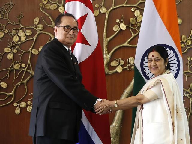 In this file photo, Indian foreign minister Sushma Swaraj, right, shakes hands with North Korea's foreign minister Ri Su Yong in New Delhi, India. Ties are warming between New Delhi and Pyongyang, with mineral-hungry India looking to boost trade with North Korea.