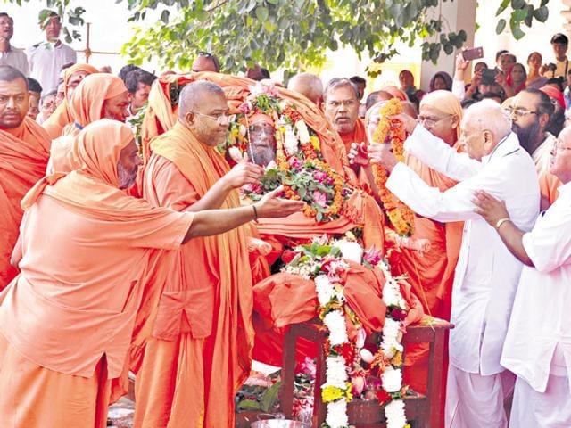 Saints pay tribute to Dayanand Saraswati during his samadhi at his ashram in Rishikesh on Friday.