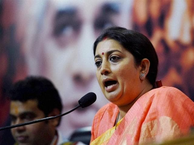 HRD minister Smriti Irani addressing a press conference at BJP headquarters in New Delhi .