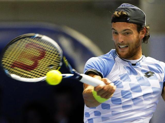 Joao Sousa of Portugal returns to Dominic Thiem of Austria during the semifinal of the St. Petersburg Open in St.Petersburg, Russia, on September 26, 2015.