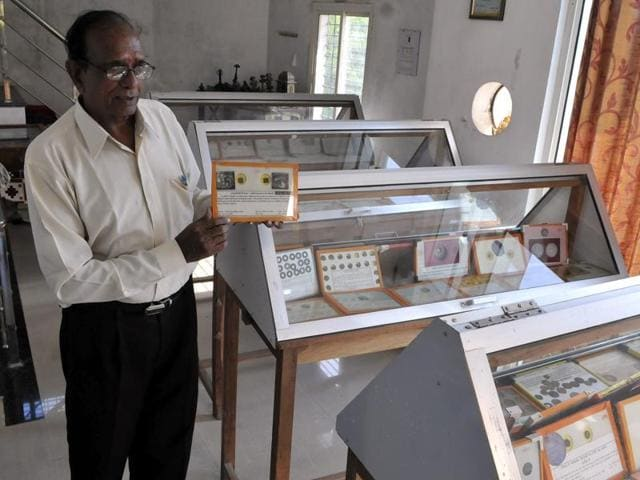 Dr Ram Chandra Thakur shows his collection of coins.