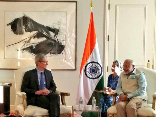 PM Narendra Modi shakes hands with Apple CEO Tim Cook. Cook has expressed interest in participating in Modi's Digital India scheme, which he has hailed as a 'game changer.'