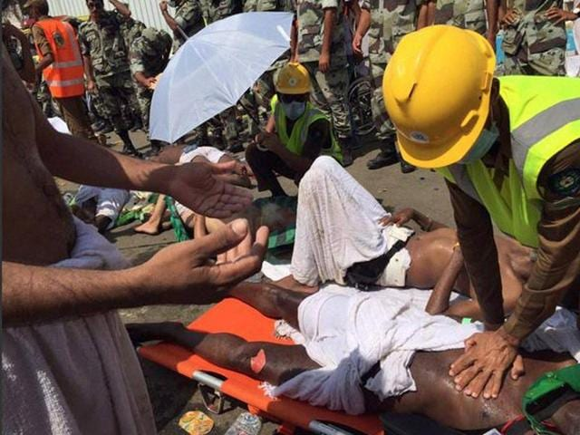 Saudi Civil Defense medic treating a pilgrim after a stampede that killed over 700 and injured nearly a thousand pilgrims in Mina during the annual haj pilgrimage.