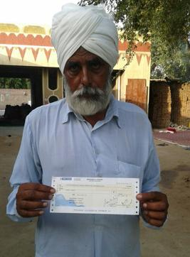 Farmer Jagtar Singh has received  a Rs 50  cheque as compensation for loss to his cotton crops.