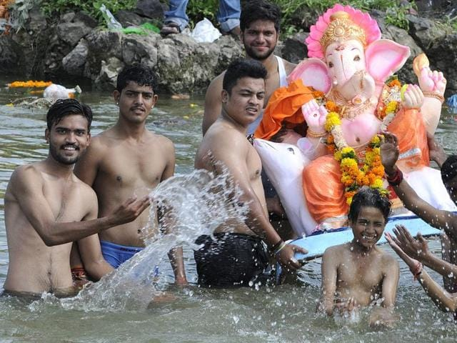 Chief minister Shivraj Singh Chouhan along with his wife Sadhna Singh immersing the Ganesha idol in a BMC pond in Bhopal on Sunday.