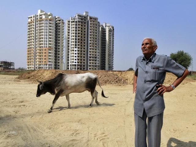 Farmers in the National Capital Region and beyond are using a section of the 2013 Land law to claim back their unused land from the state, and to demand fair compensation . In this photo, Jai Narayan, a farmer from Faridabad shows his land.