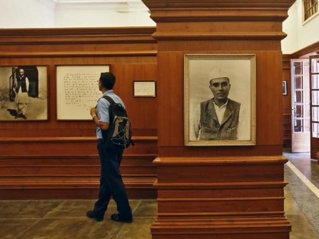A visitor stands next to a portrait of India's first Prime Minister Jawaharlal Nehru inside the Nehru memorial museum and library in New Delhi, India.