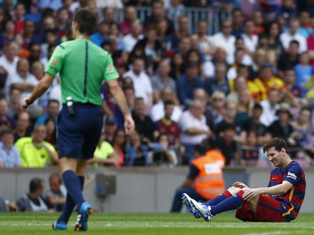 Barcelona's Lionel Messi reacts after getting injured during a La Liga match against Las Palmas at the Camp Nou stadium in Barcelona on September 26, 2015.