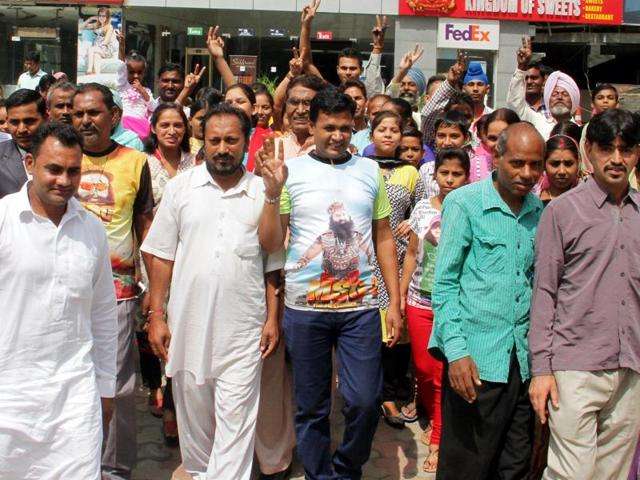 Followers of Gurmeet Ram Rahim coming out of Omaxe cinema after watching MSG-2  in Ludhiana on Sunday, September 27, 2015.