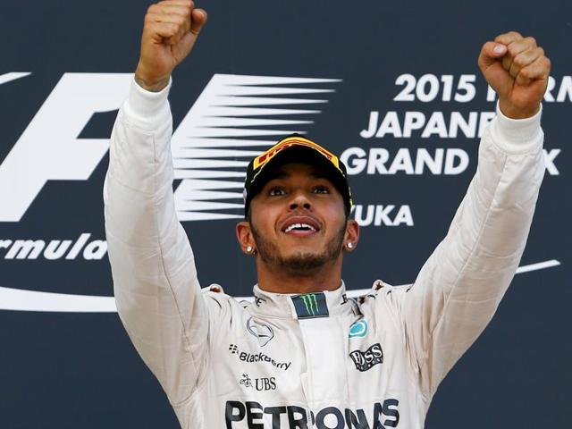 Mercedes Formula One driver Lewis Hamilton of Britain reacts as he stands on the podium after winning the Japanese F1 Grand Prix at the Suzuka circuit in Suzuka, Japan, September 27, 2015.