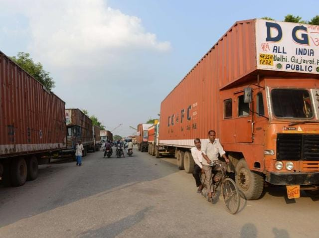 Nepalese and Indian trucks park near the Nepal-India border at Birgunj. Nepal imposed nationwide restrictions on vehicle use on growing fears of a fuel shortage.