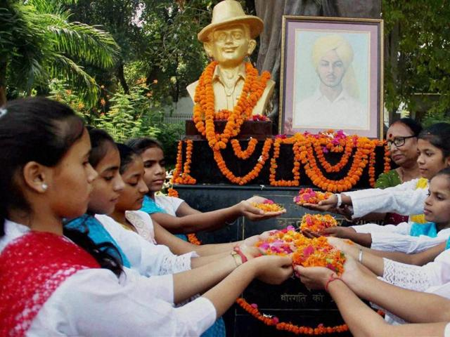 People pay homage to Bhagat Singh on his 108th Birth anniversary at Company Gardens in Allahabad on Sunday.