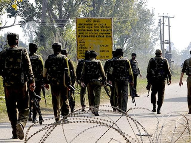 A file photo of Indian security personnel patrolling the porous Pathankot-Jammu national highway.