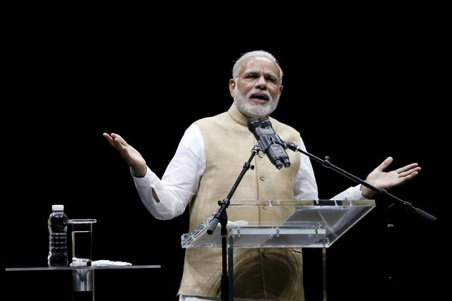 Indian Prime Minister Narendra Modi addresses the crowd during a community reception at SAP Center in San Jose, California September 27, 2015. REUTERS/Stephen Lam