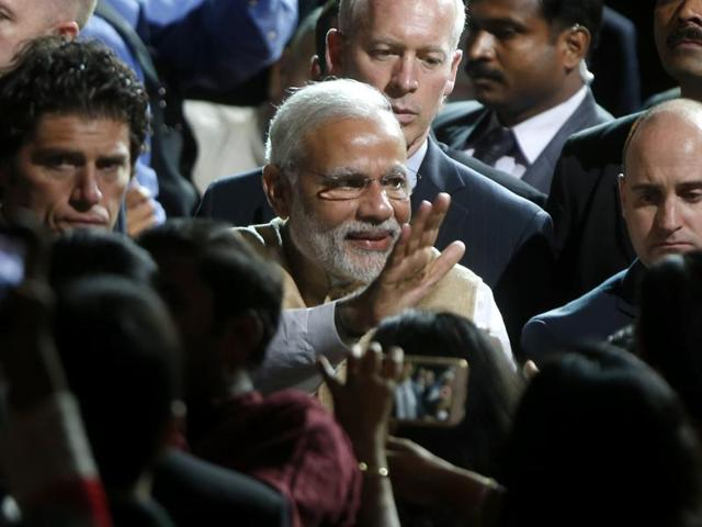 Indian Prime Minister Narendra Modi waves as he leaves the floor of the SAP Center in San Jose, Calif., Sunday, Sept. 27, 2015.