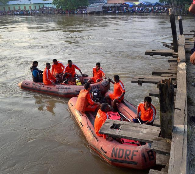 NDRF team searching for the bodies after a motor boat capsized in Kolohi river .