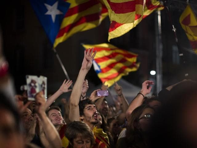 Catalonian pro-independence supporters celebrate in Barcelona, Spain on September 27, 2015.