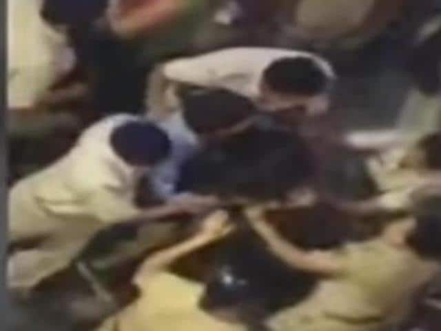 A video grab from IBN Live shows women constables beating up a woman. (YouTube/IBNLive)