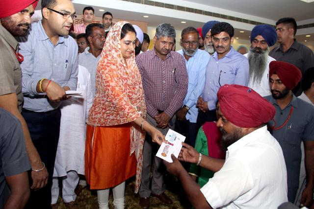 Union minister for Food Processing  Harsimrat Kaur Badal distributes cheques under Pardhan Mantari Mudra Yojana in Bathinda.
