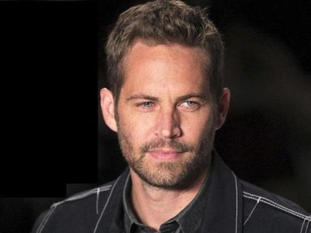 U.S. actor Paul Walker presents a creation from Colcci's 2013/2014 summer collection during Sao Paulo Fashion Week in this March 21, 2013, file photo. When actors from the Fast & Furious films gathered recently in the parking lot at Dodger Stadium to promote the seventh installment, they spent a lot of time talking about a cast member who wasn't there: Paul Walker.