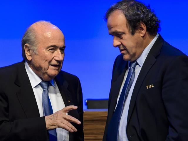 A picture taken on June 11, 2014 shows Fifa president Joseph Blatter talking to Uefa president Michel Platini during the 64th Fifa Congress in Sao Paulo, on the eve of the opening match of the 2014 Fifa World Cup in Brazil.