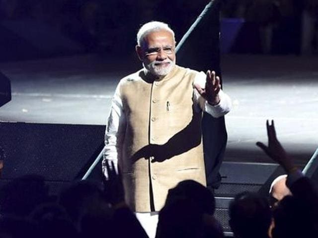 Prime Minister Narendra Modi waves to the crowd after speaking at a community reception at SAP Center in San Jose, California.