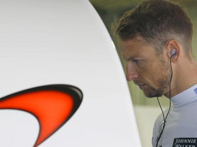 McLaren driver Jenson Button of Britain watches a monitor during the second practice session for the Japanese Grand Prix in Suzuka, Japan on September 25, 2015.