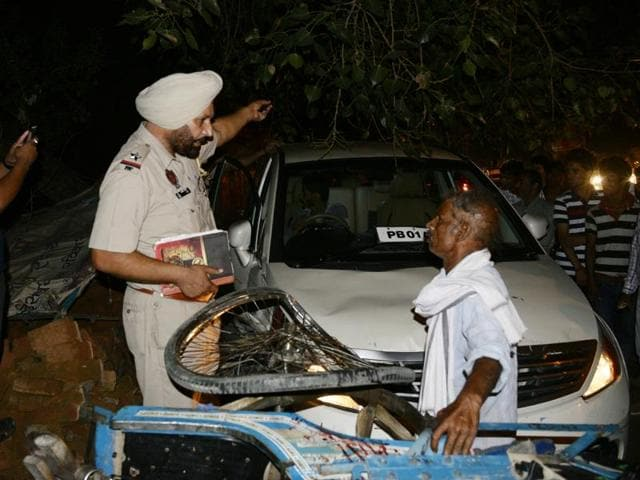 Police investigating the spot where a car hit two motorcycle riders and another man on Sunday evening in Ludhiana.