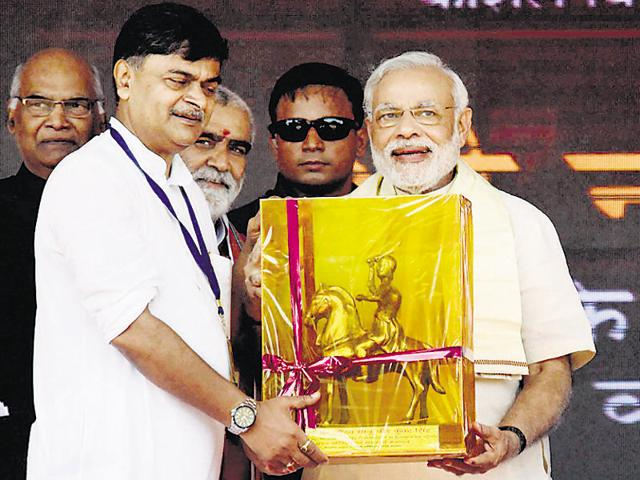 In this file photo BJP MP RK Singh receives a memento from Prime Minister Narendra Modi. Union minister Nitin Gadkari is also seen.