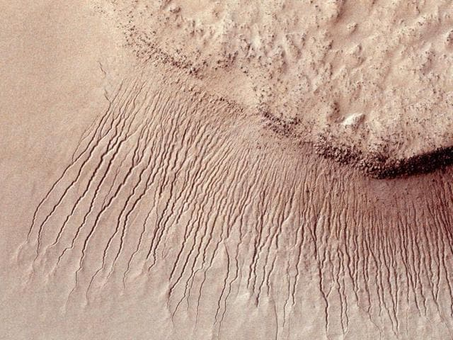 Scientists have found the first evidence that briny water may flow on the surface of Mars during the planet's summer months, a paper published on Monday showed.