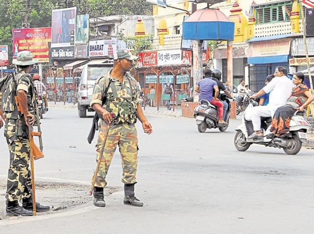 Police force on vigil in strife areas of Ranchi.