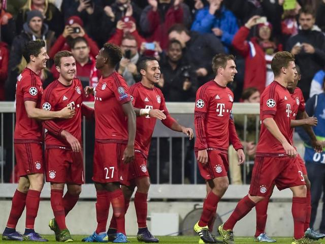 Bayern Munich players celebrate the team's fifth goal against Dinamo Zagreb during the Group F Uefa Champions League match in Munich, on September 29, 2015.