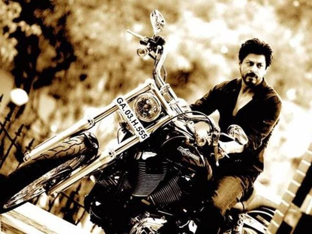 Shah Rukh Khan on the bike filmmaker Rohit Shetty gifted him.