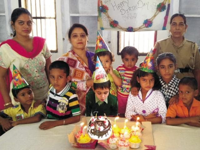 Children taking part in birthday celebrations at the women's jail in Ludhiana on Tuesday.