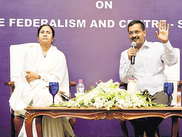 Chief minister of West Bengal Mamata Banerjee with Delhi chief minister Arvind Kejriwal during the Chief Ministers conclave on cooperative federalism and centre- state relations, in New Delhi on Wednesday.