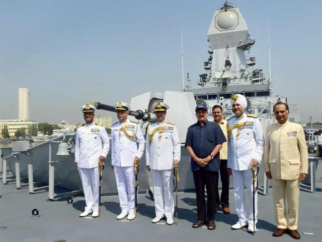 Union Defence Minister Manohar Parrikar, R K Dhowan (3rd from L), Chief of Naval Staff, S P S Cheema (5th from L), Commanding in Chief, Western Naval Command along with other officers during the commissioning of naval warship INS Kochi in Mumbai .