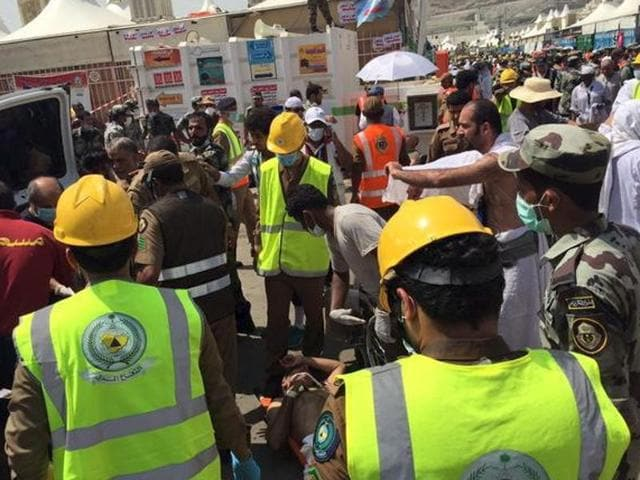 Members of Saudi Civil Defence try to rescue pilgrims following a crush caused by large numbers of people pushing at Mina, outside the Muslim holy city of Mecca.