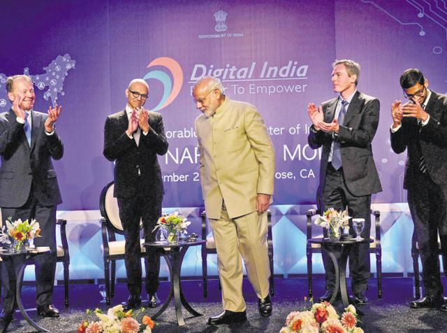 Prime Minister Narendra Modi with Microsoft CEO Satya Nadella (2nd L), John T Chambers, executive chairman of Cisco, Paul E Jacobs, executive chairman of Qualcomm and Google CEO Sundar Pichai (R) during the Digital India and Digital Technology dinner function in San Jose.