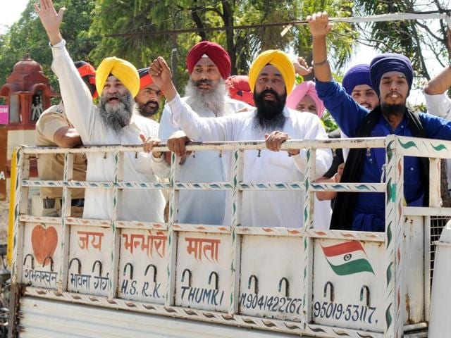 Police arrest protesting Sikhs as precautionary measure in Patiala on Wednesday.