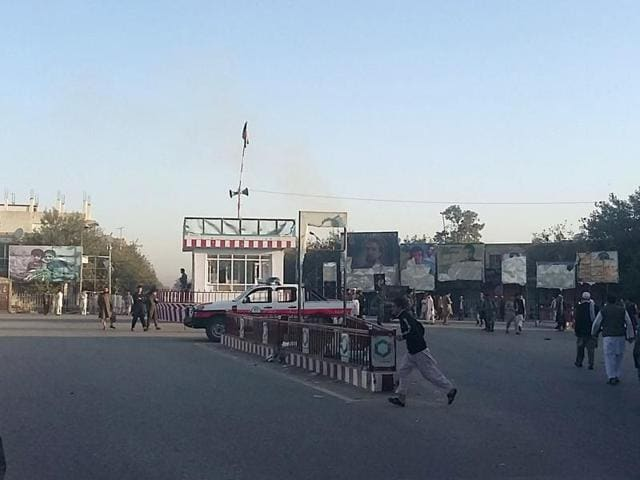 Afghans walk in the main square of Kunduz city, north of Kabul, Afghanistan.