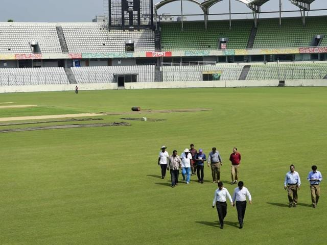Bangladesh Cricket Board officials walk on the field at the Sher-e-Bangla Cricket Stadium at Mirpur in Dhaka, on September 30, 2015. Australia  called off a two-Test tour of Bangladesh on October 1 citing terrorism fears after official warnings militants may attack Western interests.