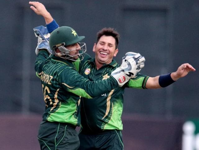 Pakistani bowler Yasir Shah, right, celebrates a wicket with wicketkeeper Sarfraz Ahmed during the first match of the three-ODI series against Zimbabwe at the Harare