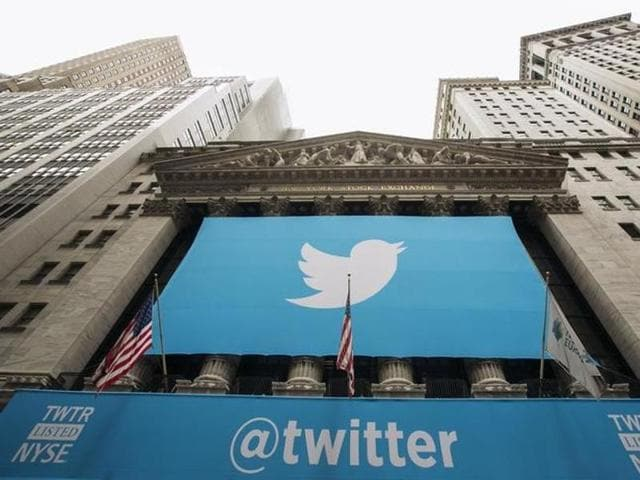 A sign displays the Twitter logo on the front of the New York Stock Exchange.