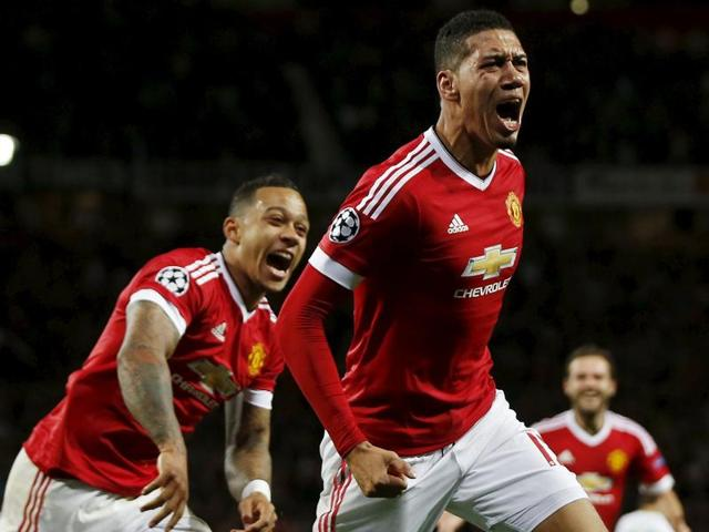 Chris Smalling, centre, celebrates scoring the second goal for Manchester United in the Uefa Champions League Group stage match against VfL Wolfsburg at Old Trafford, on September 30, 2015.
