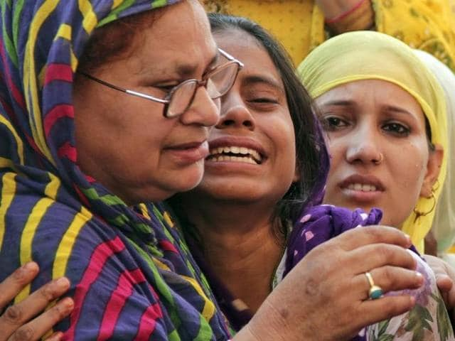 Relatives of Mohammad Akhlaq mourn after he was killed by a mob on Monday night at his residence in Dadri town, in Uttar Pradesh.