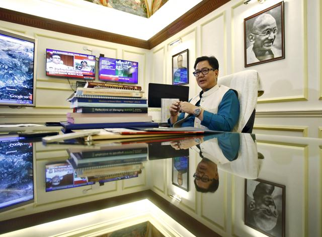 Union minister of state for home Kiren Rijiju speaks during an interview with Reuters inside his office in New Delhi.
