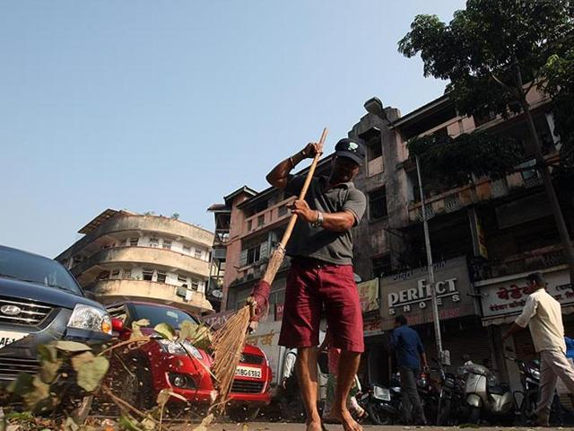 Workers sweep a market as they participate in the nationwide Swachh Bharat mission in Mumbai.