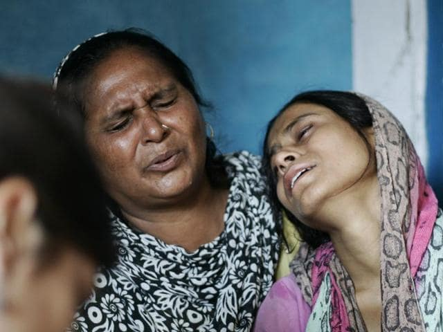 Relatives of Ikhlaq mourn during his funeral at their village in Bisada, Greater Noida. Ikhlaaq was beaten to death by a mob.